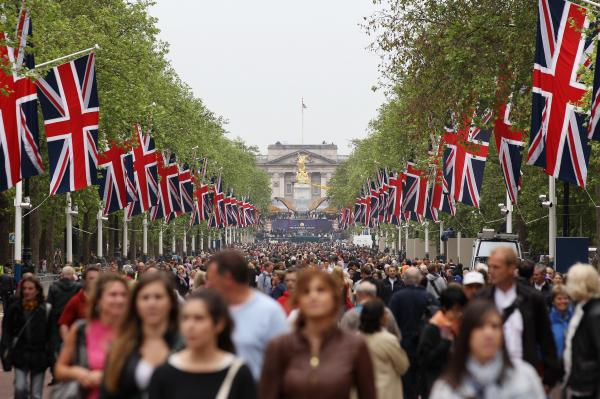 Members of the public walk along The Mall, which is closed to traffic for the Diamond Jubilee weekend in London.