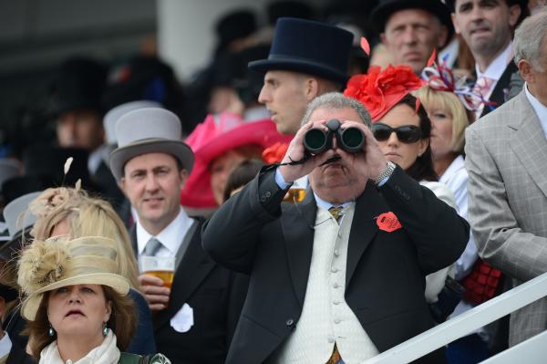 Racegoers attend Derby Day, the second day of the Epsom Derby horse racing festival, on Saturday.