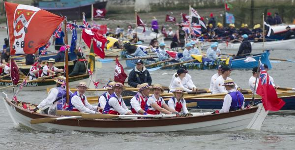 Hundreds of thousands of Union Jack-waving spectators formed a red, white and blue wave along London's riverbanks and bridges, cheering the 86-year-old monarch and her armada of motorboats, rowboats and sailboats of all shapes and sizes.
