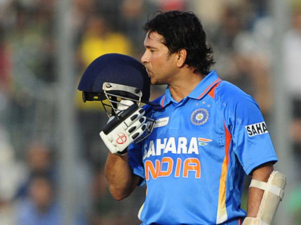 Sachin Tendulkar kisses his helmet after scoring his 100th century (100 runs) in a March match against Bangladesh.