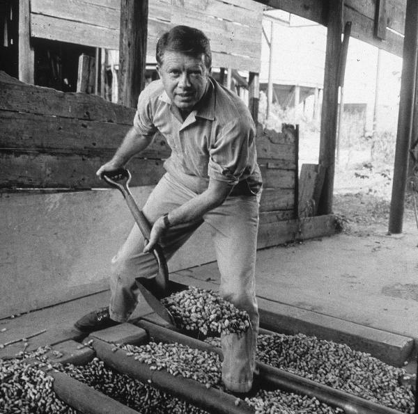 Jimmy Carter shovels peanuts in an image from the 1970s.