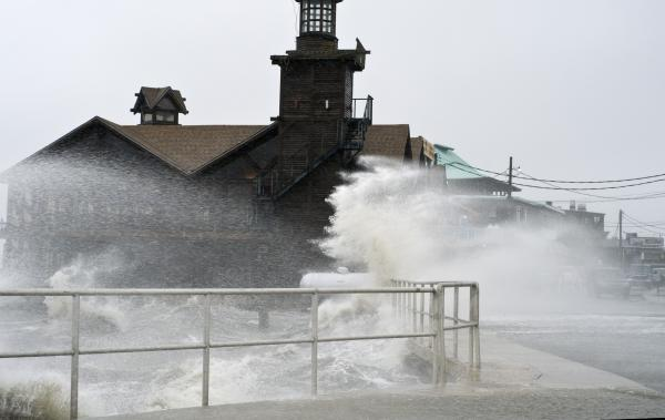 High winds, high tide strike at the main street of Cedar Key, Fla., as Tropical Storm Debby makes its way across the Gulf of Mexico on Sunday.