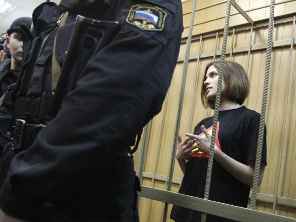 Nadezhda Tolokonnikova is one of three women jailed in connection with the protest. They have been charged with hooliganism and could receive up to seven years in prison. She is shown here in a defendant's cage before a court hearing in Moscow in April.
