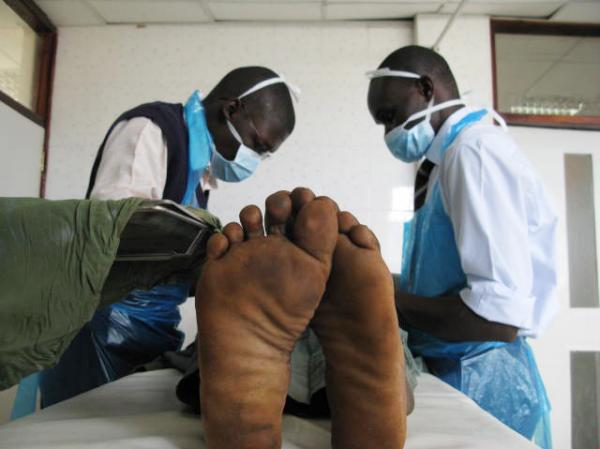 Joseph Ochieng, 18, gets circumcised at the Siaya General Hospital in western Kenya.