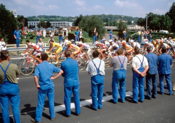 """I was out on the course and there was nothing. Then all of a sudden the road came up on a factory, and there was a sea of workers in blue uniforms. It was perfect — the pattern of the blue bibs,"" says Startt about this photo from the 1997 Tour."