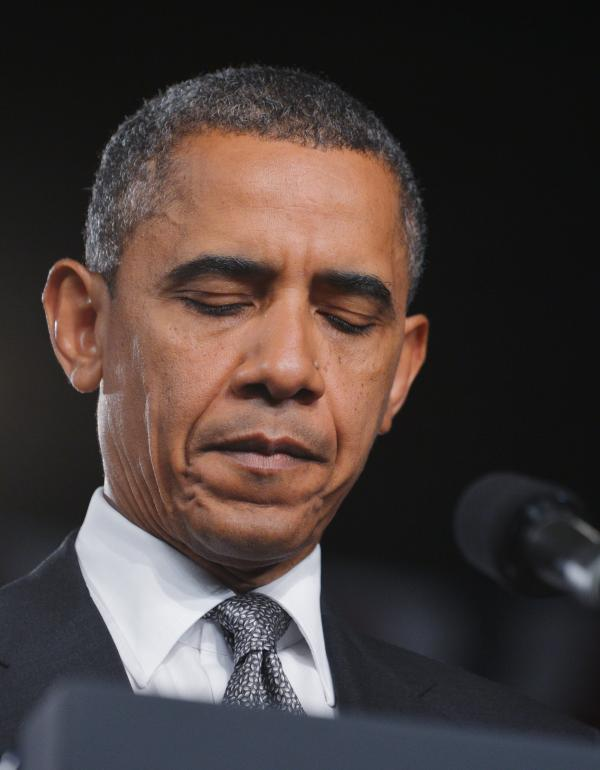 President Obama turned a planned campaign speech in Fort Myers, Fla., into a brief statement about the shooting rampage. He asked the audience to join him in a moment of silence for the victims.