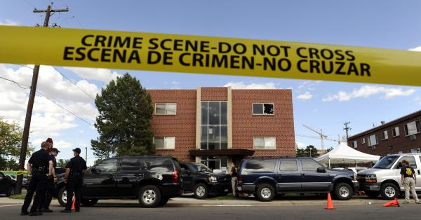 Police surround the apartment of James Holmes, the suspect in the Colorado theater shooting, on Friday in Aurora, Colo.