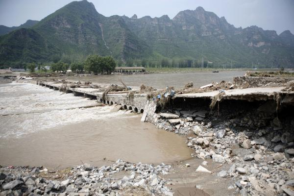 A bridge leading to the town of Laishui, north of Beijing, collapsed on Tuesday.