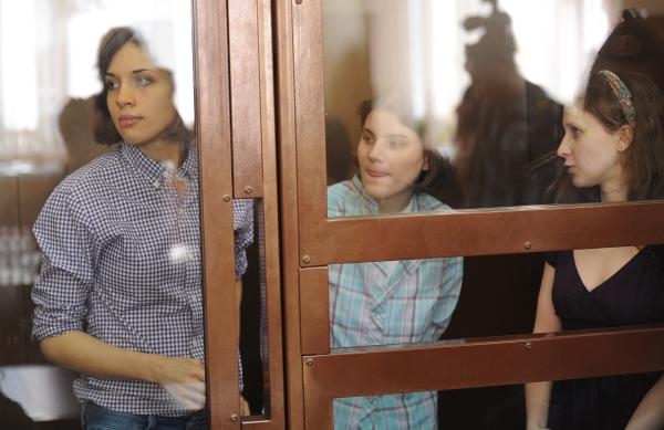 Members of the feminist punk band Pussy Riot, Nadezha Tolokonnikova (left), Yekaterina Samutsevich (center) and Maria Alyokhina, at a hearing in Moscow court on Monday.