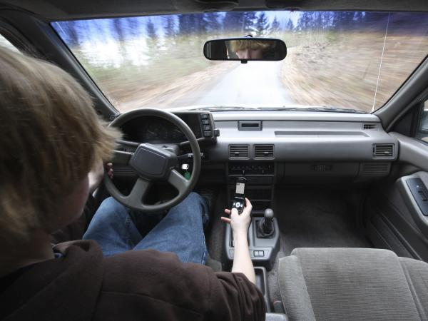 Drivers under 25 are more likely to send text messages and make calls behind the wheel. They're also less able to handle distractions while driving.