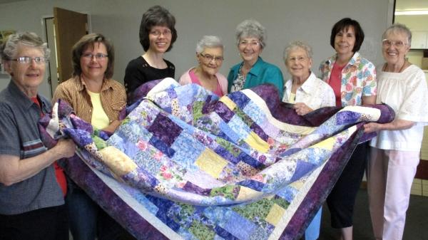 Juanita Ryan (far left), Lori Westphal, Maureen Foster, Othelia Schulz, Karen Pagett, Delores Rosin, Kim Randall, Gladys Pearce. The sewing circle tries to help abused women and children start new lives.