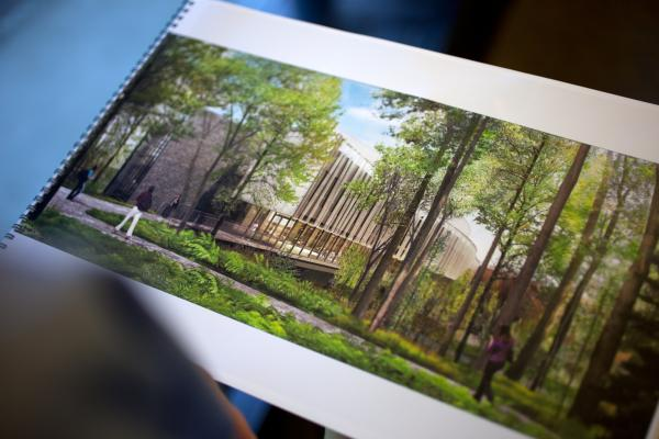 Architect Guy Maxwell holds a printout of his proposed design for the new Bridge Building at Vassar College in Poughkeepsie, N.Y.