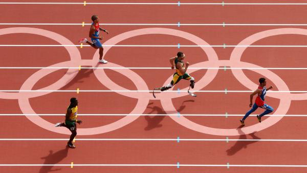 Oscar Pistorius of South Africa, center, became the first amputee to run in the Olympics. He came in second to Luguelin Santos of the Dominican Republic, to advance to the men's 400m semifinals.