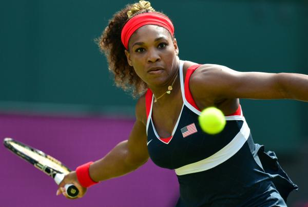 Serena Williams hits a return to Russia's Maria Sharapova during their final tennis match in the 2012 London Olympic Games at the All England Tennis Club in Wimbledon. Williams won, 6-0, 6-1.