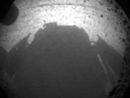 Curiosity's shadow on the surface of Mars, just minutes after the rover landed on the surface of the planet.