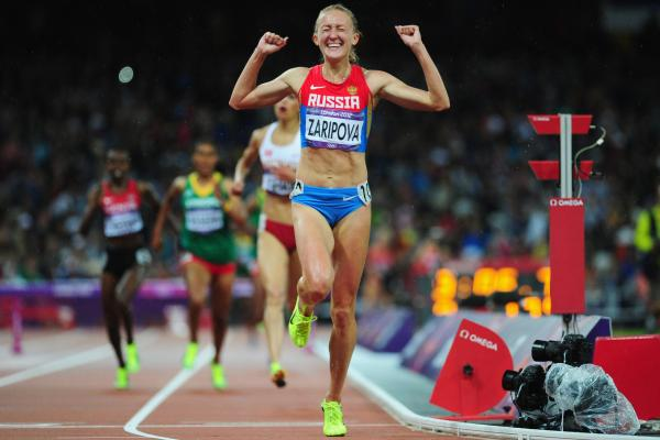 Yuliya Zaripova of Russia celebrates as she crosses the finish line to win the gold medal in the women's 3,000-meter steeplechase final.