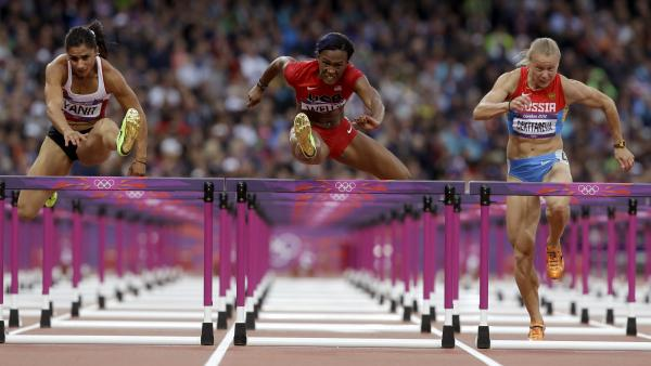 Turkey's Nevin Yanit (from left) United States' Kellie Wells and Russia's Tatyana Dektyareva compete in a women's 100-meter hurdles semifinal. Exactly how many yards is that?