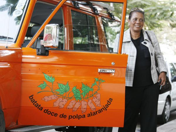 Sweet potato evangelist Maria Isabel Andrade from the International Potato Center drives around Mozambique in her orange Toyota Land Cruiser.
