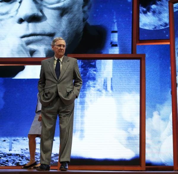 Sen. Minority Leader Mitch McConnell, R-Ky., checked out the Republican Convention stage in Tampa on Sunday. The backdrop is in honor of Apollo 11 astronaut Neil Armstrong, the first man to walk on the moon, who died over the weekend.