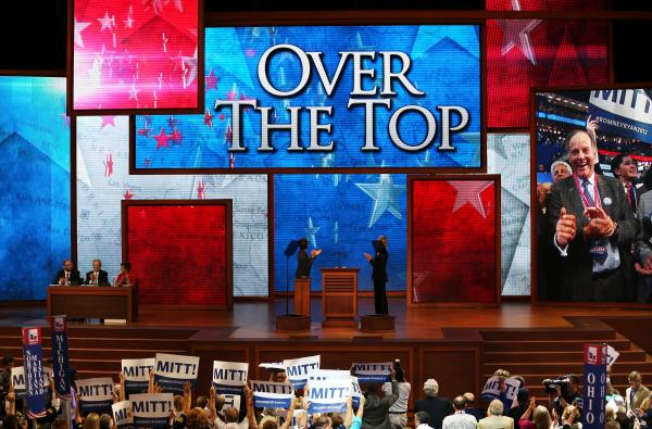 """People cheer during the roll call of states as delegates from New Jersey put Romney """"over the top,"""" giving him the official nod. It takes 1,144 delegates to become the nominee."""