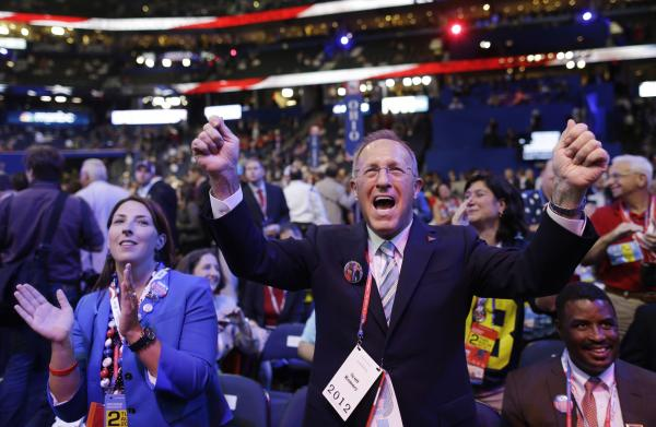 Ronna Romney McDaniel, Mitt Romney's niece, and Scott Romney, his brother, cheer at the convention.