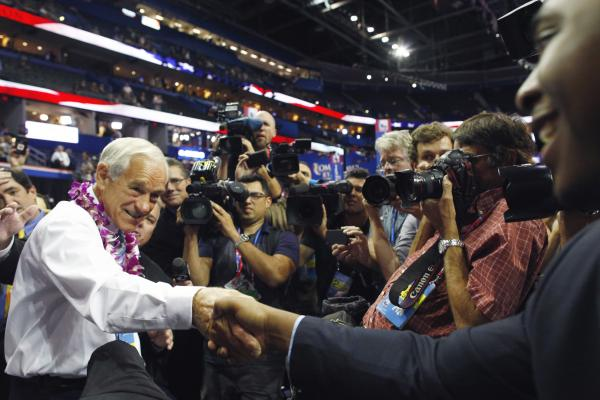 Texas Rep. Ron Paul greets convention goers. Paul supporters booed loudly and chanted against new rules adopted Tuesday that determine how delegates are apportioned in each state.