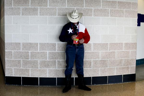 A delegate from Texas takes a break from the convention's festivities. Many of the delegates showed their hometown pride and patriotism through unique hats.