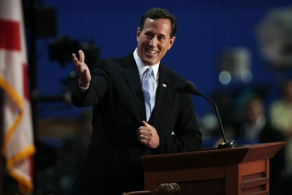 "Former Pennsylvania Sen. Rick Santorum addresses the Republican National Convention in Tampa, Fla., on Tuesday. ""Under President Obama,"" Mitt Romney's former rival said, ""the dream of freedom and opportunity has become a nightmare of dependency with almost half of America receiving some government benefit."" Mitt Romney, he said, would change that."