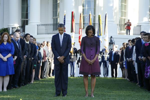 President Obama, first lady Michelle and members of the White House staff pause for a moment of silence to mark the anniversary on the South Lawn of the White House.