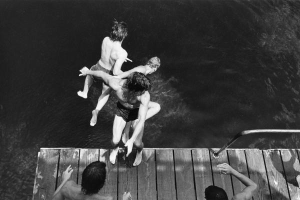 Three boys jumping off diving platform, Wakulla Springs, Fla., 1980