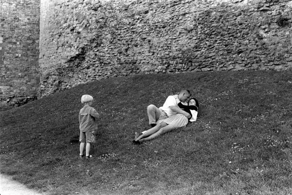 Couple embracing by castle, Cardiff, Wales, 1993