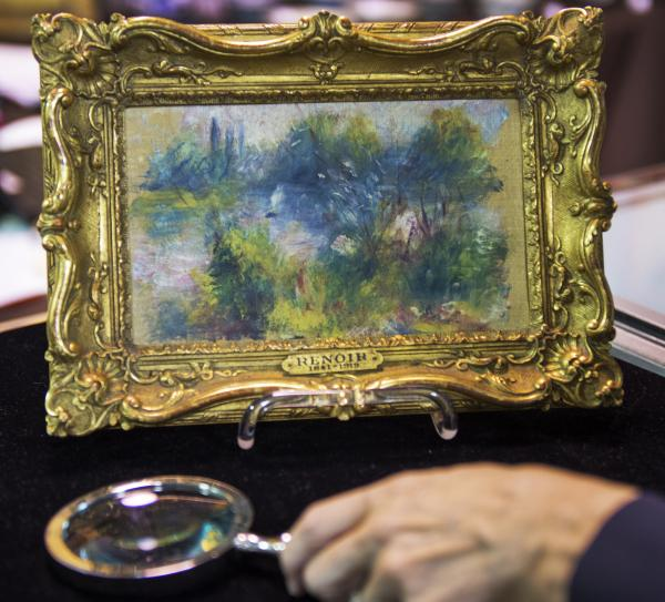 This weekend's auction of a flea-market find that turned out to be a work by French Impressionist master Pierre-Auguste Renoir has been put on hold, after evidence turned up the painting had been pilfered from a Baltimore museum decades ago.