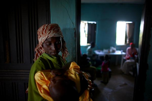 Gado Labbo holds her 5-year-old son, Yusuf, at the clinic in Dareta. In 2010, when Yusuf first entered the clinic, he had a blood lead level of 150 micrograms per deciliter — 30 times higher than what the Centers for Disease Control and Prevention considers dangerous.