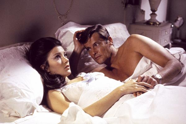 A scene from 1973's <em>Live and Let Die</em> features Jane Seymour and Roger Moore. In the film, Moore wears a supermagnetic wristwatch said to deflect bullets at long range.