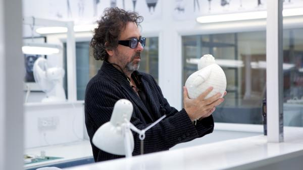 Tim Burton, seen here with a stop-motion puppet, has made several films using the time-intensive style, including <em>The Nightmare Before Christmas</em>, <em>Corpse Bride</em> and his latest film, <em>Frankenweenie</em>.