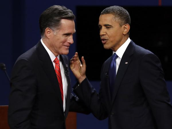 Republican presidential nominee Mitt Romney and President Obama talk after the first presidential debate at the University of Denver on Wednesday.