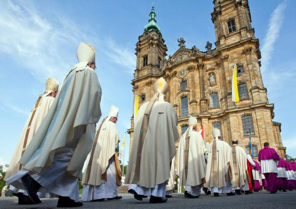 Bavarian bishops walk in a procession to the Basilica of the Fourteen Holy Helpers near Bad Staffelstein, Germany, in May. A decree by the German bishops' conference warns that German Catholics who do not pay a state church tax will be denied sacraments.