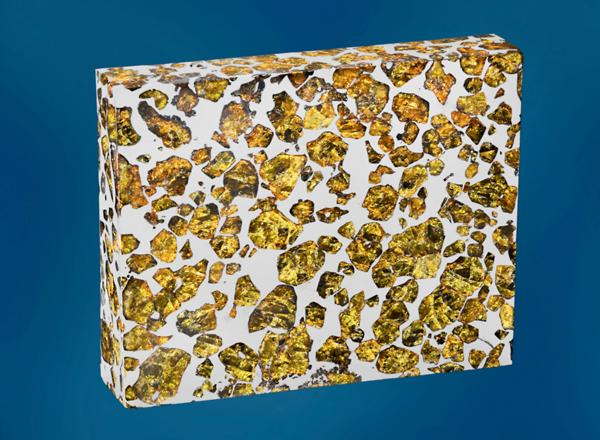 <strong>Good Enough To Eat?</strong> No, it's not nougat (though it does look a bit like the honey, sugar, egg white and nut confection). Those are olivine and peridot crystals suspended in a piece of the Fukang meteorite found in China's Gobi Desert. Estimated price: $100,000-$120,000.