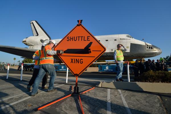 "After trundling out of the Los Angeles International Airport on Friday, Endeavour hit the pavement before dawn again on Saturday on a remote-controlled 160-wheel carrier past diamond-shaped ""Shuttle Xing"" signs."