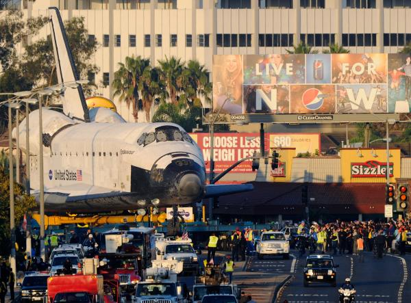 The shuttle could not be taken apart without damaging the delicate tiles. Airlifting it was out of the question, so was driving on freeways since it's too massive to fit through underpasses.