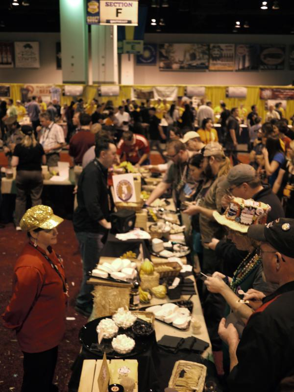 <p>Festival goers line up for cheese between beer tastings. Many people arrive at the festival wearing necklaces hung with pretzels to munch on.</p><p></p>