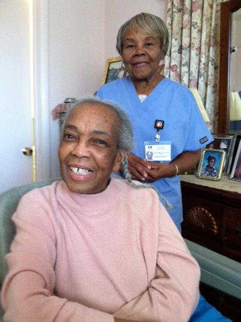 Onether Lowery, 80, (standing) is a home health aide for Rosalie Lewis, 86. As a whole, the aides are largely female and far older than women in the general workforce.