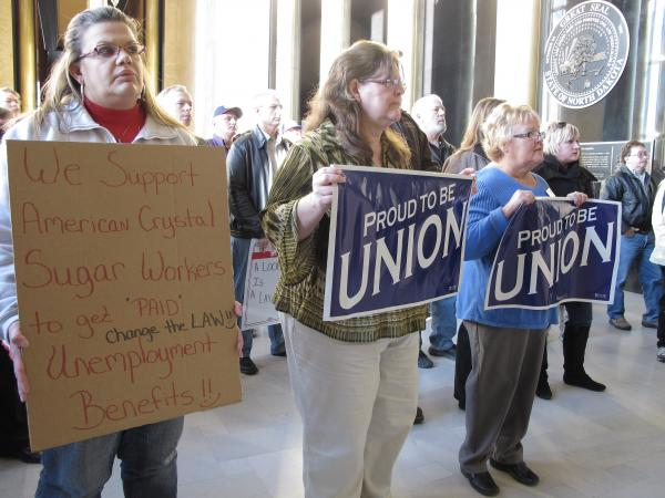 Supporters of American Crystal Sugar Co. workers, who have been locked out of the company's sugar beet processing plants since 2011, rally in the North Dakota Capitol.