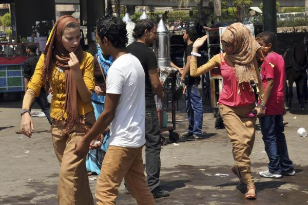 Young men harass women in Cairo. Such episodes surged during the Muslim holiday last month.