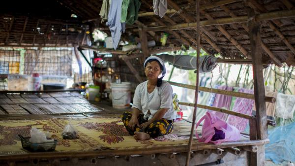 Daw Khin Twon, an undocumented immigrant from Burma, rests at home after receiving malaria treatment at the Mae Tao Clinic in Mae Sot, Thailand.