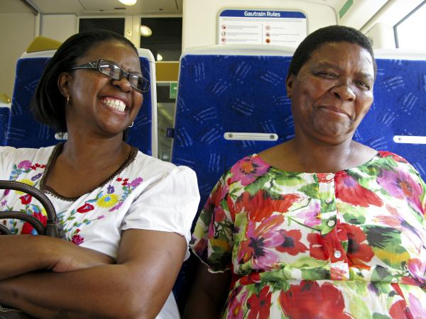 Refilwe Edith Seabi (left) and her sister Girlie are taking the Gautrain from Pretoria to go shopping in Johannesburg. Seabi is pleased when the ride clocks in at 30 minutes — compared with a drive that sometimes takes her two hours.