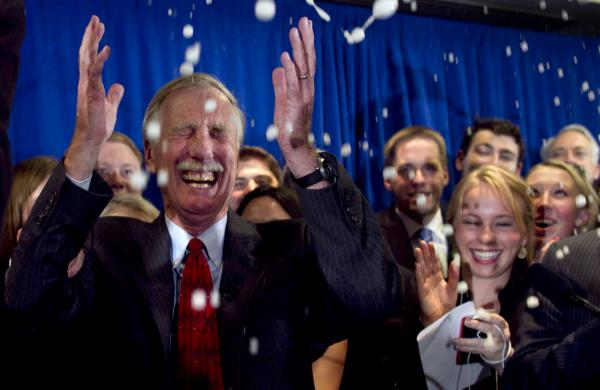 Independent Angus King celebrates under a splash of champagne in Freeport, Maine, on Tuesday, after winning the Senate seat vacated by Republican Olympia Snowe.
