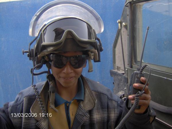 Ali, an Iraqi teenager, wears Spc. Justin Cliburn's helmet and radio equipment in Baghdad. Ali and Cliburn became unlikely friends while Cliburn trained Iraqi police in 2005 and 2006.