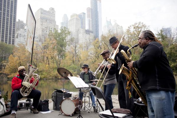 Tuba player Bob Stewart's quintet played at the pond, near the southeast entrance of the park.