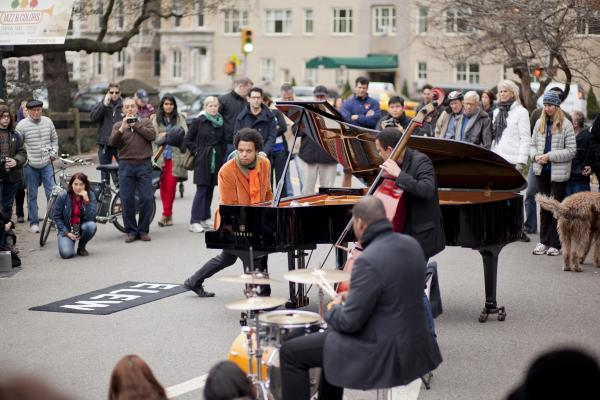 The pianist Eric Lewis, known as ELEW, played unamplified with a trio at the West 90th Street entrance to the park.